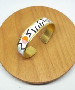 bracelet manchette laiton doré années 80 blanc noir couleurs arty